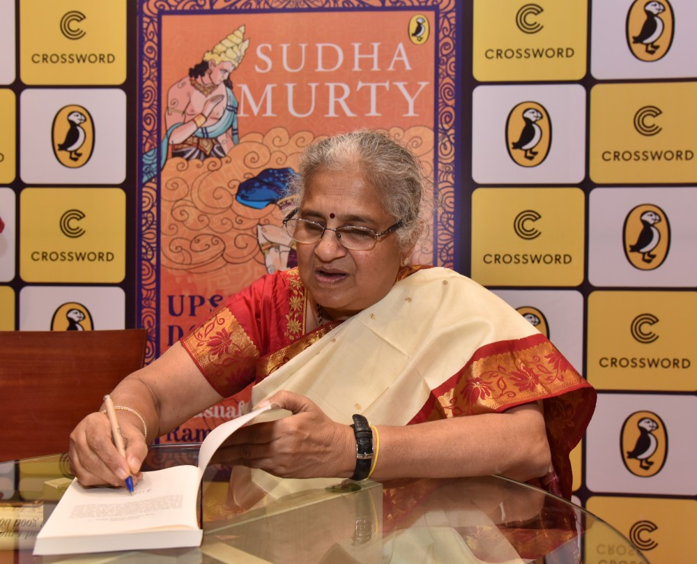 Author Sudha Murty singing a copy of The Upside Down King